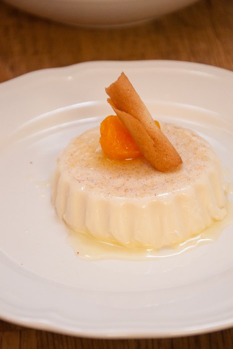Cinnamon and vanilla panna cotta with stewed clementine and coconut tuille